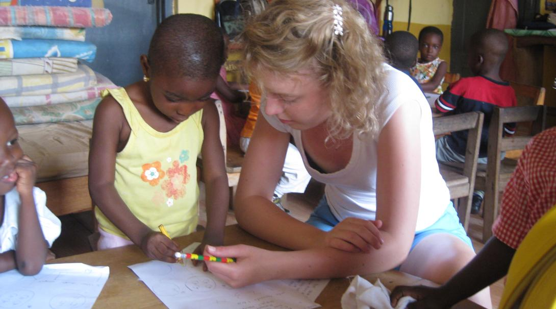 Projects Abroad volunteer observes her student while working with children in Ghana
